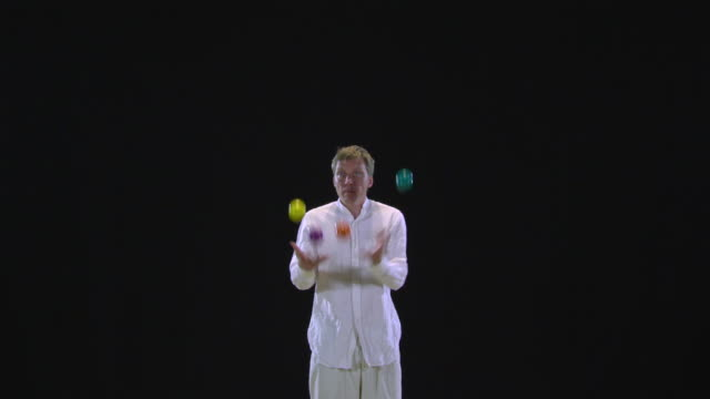 ws professional juggler juggling four balls and then catching them all in one hand / berlin, germany - juggler stock videos and b-roll footage