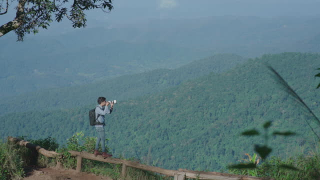 professional landscape photographer taking photos at nature mountain view - mack2happy stock videos and b-roll footage
