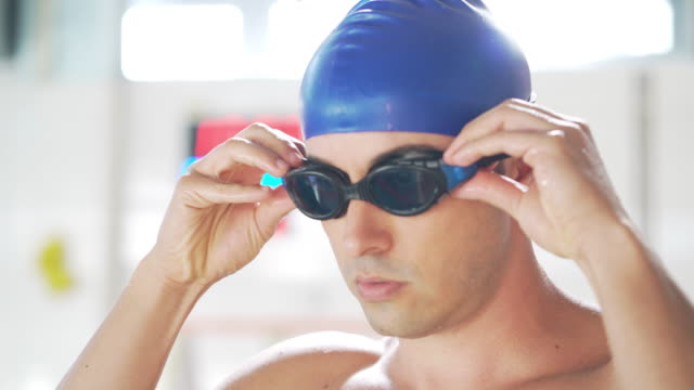 professional male swimmer - swimming goggles stock videos & royalty-free footage