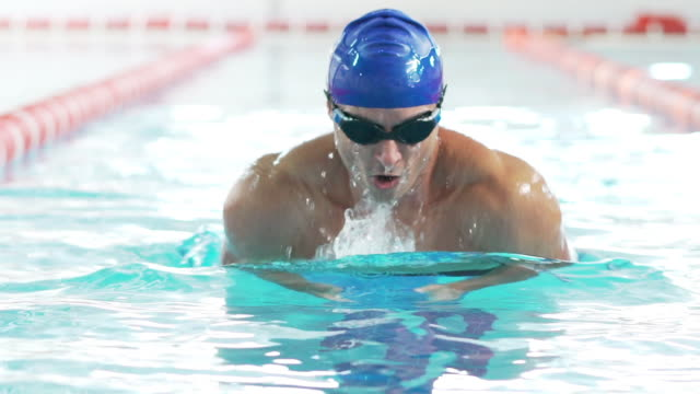 professional male swimmer - swimming cap stock videos & royalty-free footage