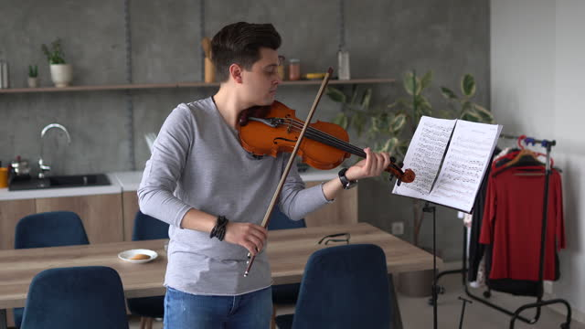 professional male violinist rehearsing music piece at home - sketch comedy stock videos & royalty-free footage