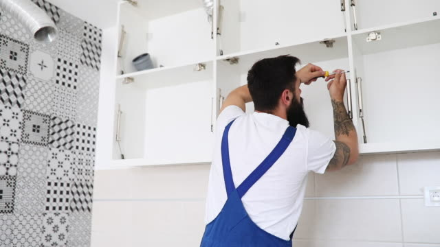 professional male worker assembling furniture - renovation stock videos & royalty-free footage