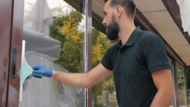 professional manual worker cleaning window - window washer stock videos & royalty-free footage