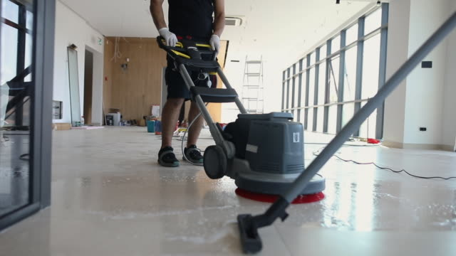professional manual workers cleaning floor together as a team - flooring stock videos & royalty-free footage
