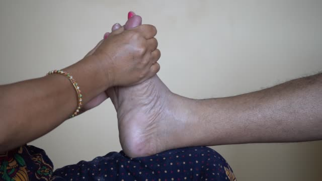 professional massage therapist doing foot massage to a man. massage therapy and health concept - viziarsi video stock e b–roll