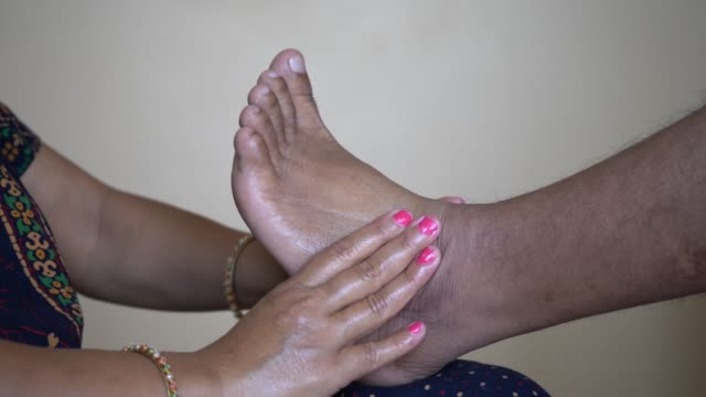 professional massage therapist doing foot massage to a man. massage therapy and health concept - verwöhnen stock-videos und b-roll-filmmaterial