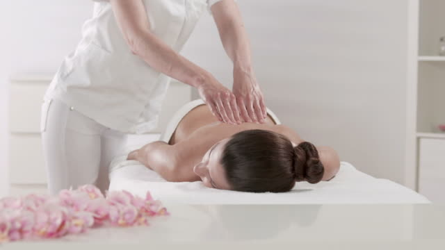 hd dolly: professional massage - massage table stock videos & royalty-free footage
