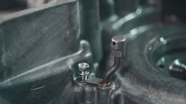 professional mechanic repairing a car in auto repair shop - wrench stock videos and b-roll footage