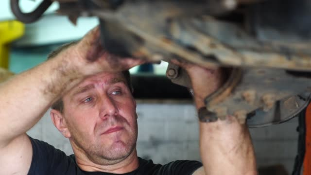 professional mechanic repairing a car in auto repair shop - repair garage stock videos & royalty-free footage