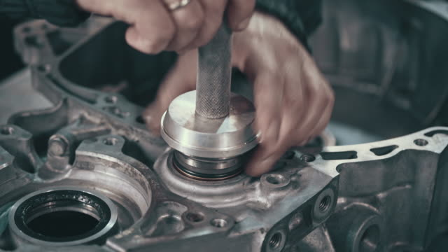 professional mechanic repairing a continuously variable transmission - motor oil stock videos and b-roll footage