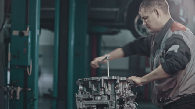 Professional mechanic repairing a continuously variable transmission