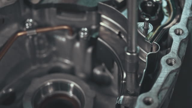 professional mechanic repairing a continuously variable transmission - quality control stock videos and b-roll footage