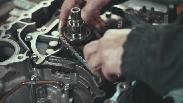 professional mechanic repairing a continuously variable transmission - engine stock videos and b-roll footage