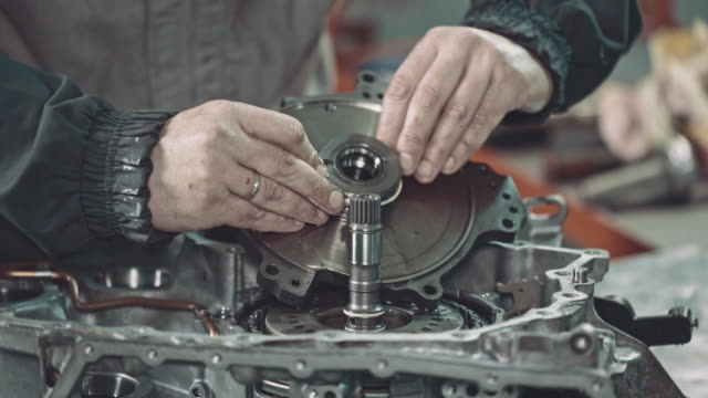 professional mechanic repairing a continuously variable transmission - car engine stock videos & royalty-free footage