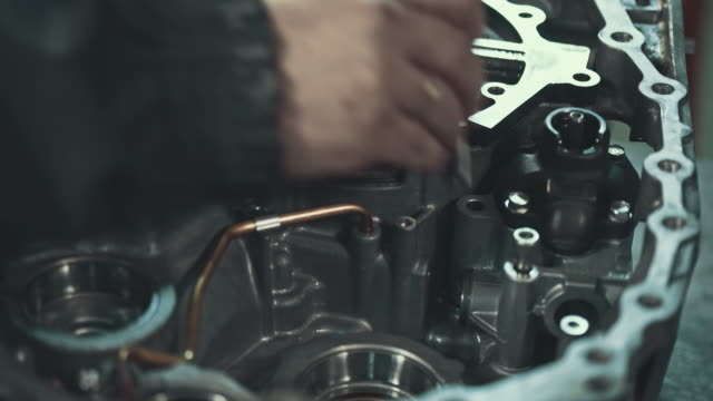professional mechanic repairing a continuously variable transmission - engine stock videos & royalty-free footage
