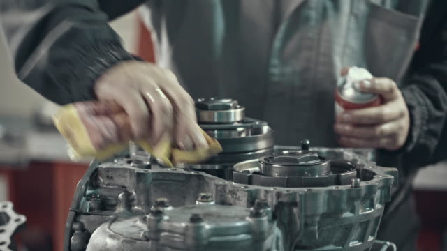 professional mechanic repairing a cvt gearbox - lubrication stock videos & royalty-free footage