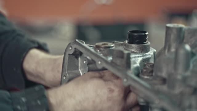 Professional mechanic repairing a CVT gearbox