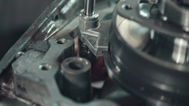 professional mechanic repairing a cvt gearbox - quality control stock videos and b-roll footage