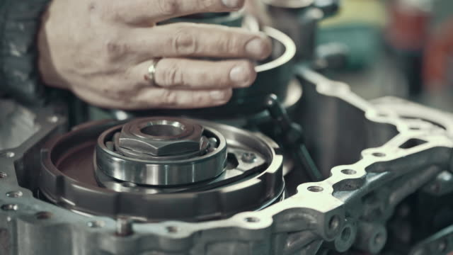 professional mechanic repairing a cvt gearbox - wrench stock videos and b-roll footage