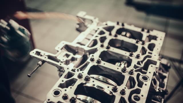 Professional mechanic repairing V10 engine in auto repair shop