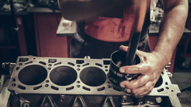 Professional mechanic repairing V10 engine in auto repair shop