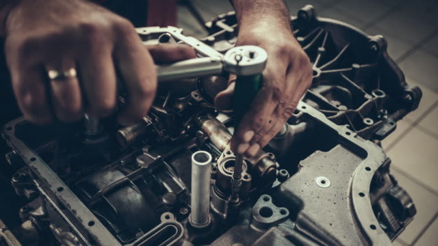 professional mechanic repairing v10 engine in auto repair shop - repair garage stock videos & royalty-free footage