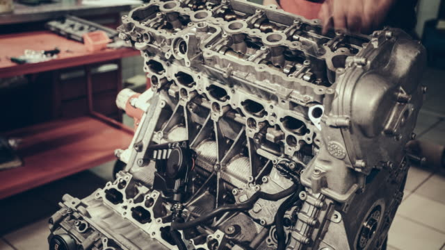 professional mechanic repairing v10 engine in auto repair shop - manufacturing machinery stock videos & royalty-free footage