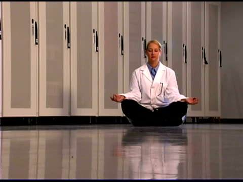 it professional meditating in lab coat - one mid adult woman only stock videos & royalty-free footage
