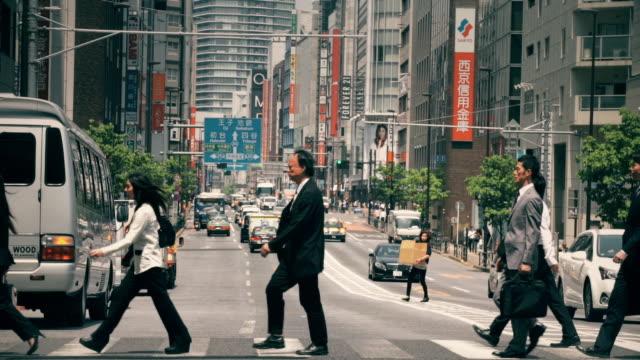 Professional Men and Women Crossing Street in Tokyo