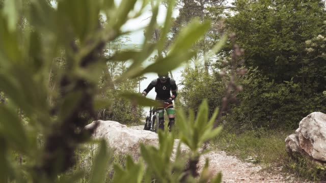 professional mountain biker pushing bike in the hill - mountain biking stock videos & royalty-free footage