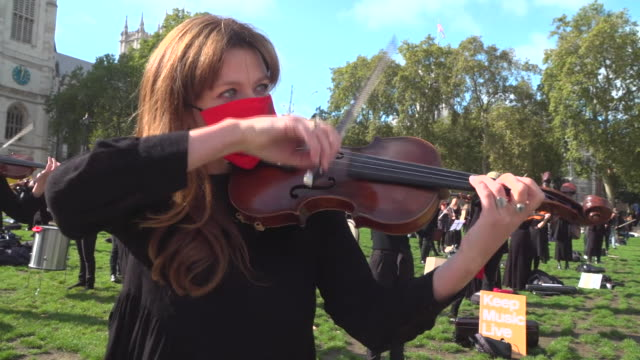 professional musicians performing in parliament square to demand more targeted state support for the industry during the coronavirus crisis - performance stock videos & royalty-free footage