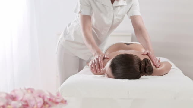 hd dolly: professional oil massage in spa center - massage table stock videos & royalty-free footage