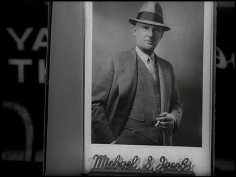 Professional picture in frame of founder boxing promoter Michael 'Mike' S Jacobs dressed in suit hat holding cigarette