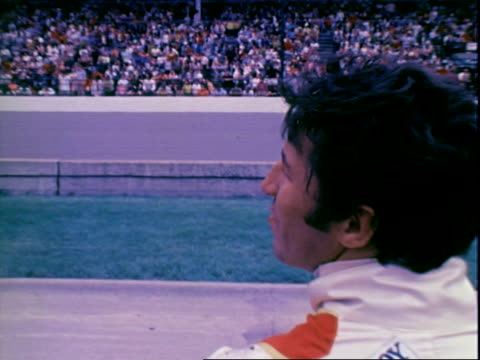 cu professional race car driver mario andretti wearing civilian clothes silvertrim sunglasses while standing in pits prerace of indianapolis 500 /... - qualification round stock videos & royalty-free footage