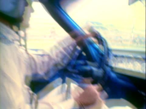 stockvideo's en b-roll-footage met professional race car driver richard petty wearing wide floppy brim amishstyle felt hat black leather jacket striped polyester pants long sideburns... - veiligheidsgordel