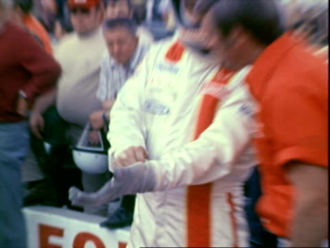 professional racecar driver al unser sr wearing racing jumpsuit, squinting eyes while standing in pits during pre-race heats at indianapolis 500 race... - sports glove stock videos & royalty-free footage