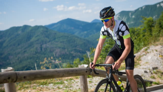 Professional road cyclist pedaling standing up