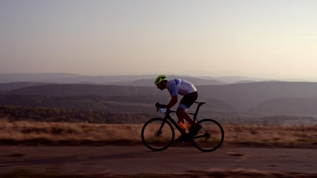 professional road cyclist - side view stock videos & royalty-free footage