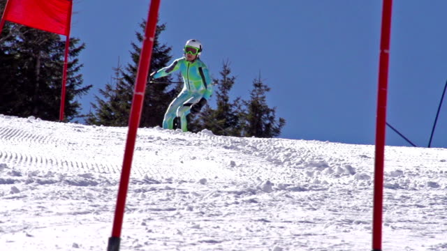 HD: ZOOM, Professional Skier Practicing Giant Slalom