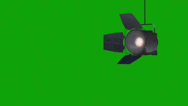 vídeos de stock e filmes b-roll de professional stage light with reflector animation on the green screen, design element of lighting equipment , moving and turning studio film spotlight projector with lens flares. - iluminado por holofote