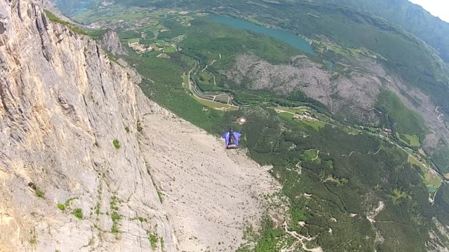professional stunt man gary connery heads to brento, near arco in italy for his final wingsuit training flights before his attempt to become the... - air vehicle stock videos & royalty-free footage