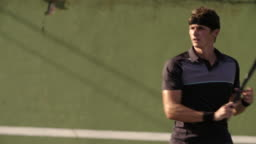 Professional tennis player practicing forehands shots