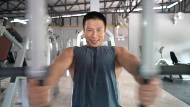 professional trainer big muscle working out his chest muscle in the gym - exercise machine stock videos & royalty-free footage