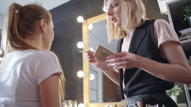 Professional transgender make-up artist working in studio
