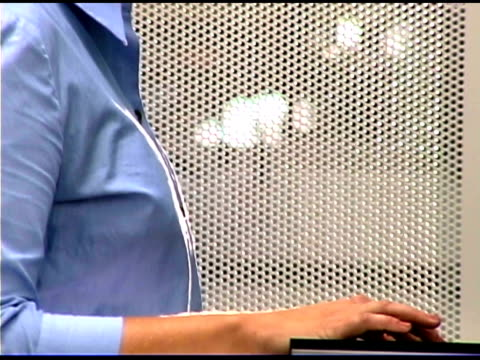 it professional using laptop computer by network server - only mid adult women stock videos & royalty-free footage