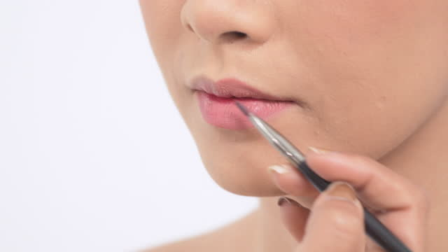 professional women makeup artist doing makeup model. - lips stock videos & royalty-free footage