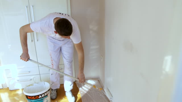 professional worker painting interior wall - part time worker stock videos & royalty-free footage