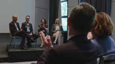 professionals clapping for businessman at seminar - leadership stock videos & royalty-free footage