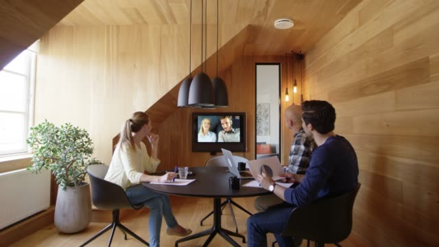 professionals planning in video conference at office - small group of people stock videos & royalty-free footage
