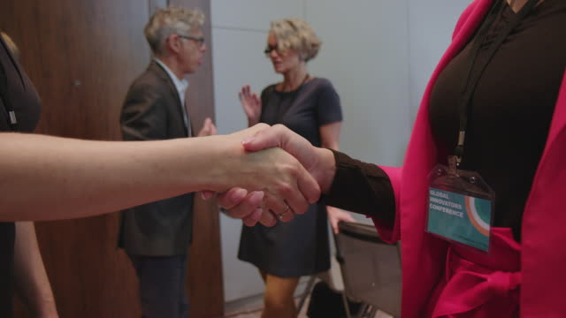 professionals shaking hands during seminar - auditorium stock videos & royalty-free footage